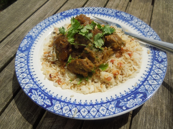 Image of lamb and apricot tagine served with rice pilaf