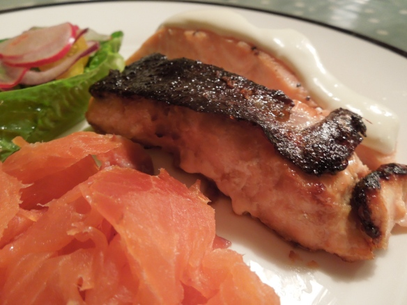 Image of Salmon Three Ways served with salad