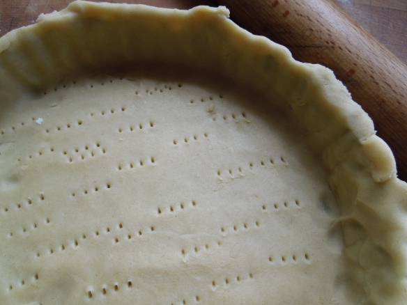 Image of tart tin lined with pastry