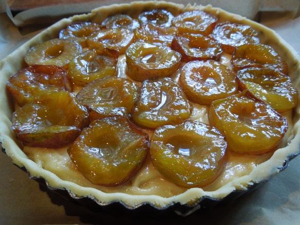 Image of plums pressed into frangipane filling