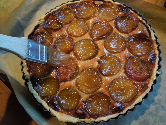 Image of apricot glaze being brushed onto cooked tart