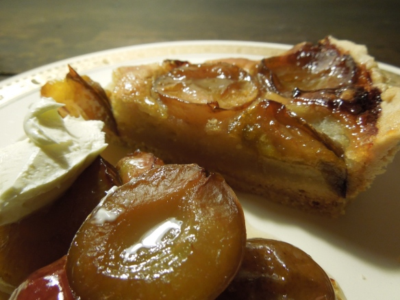Image of tart served with plum compote and creme fraiche