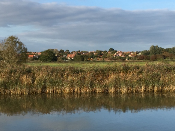 Image of River Alde with Snape village in the background
