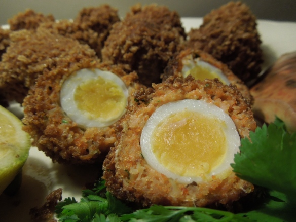 Image of crab meat and smoked salmon Scotch eggs in close-up