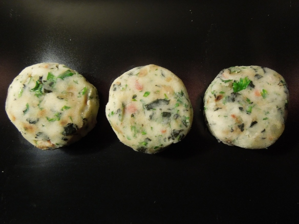 Image of potato cakes with kale and bacon formed into patties