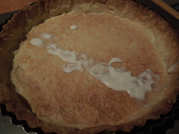 Image of a tart case with emergency flour and water paste gluing a crack