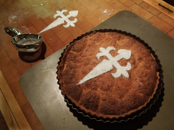 Image of tart and a practice session with the template and icing sugar