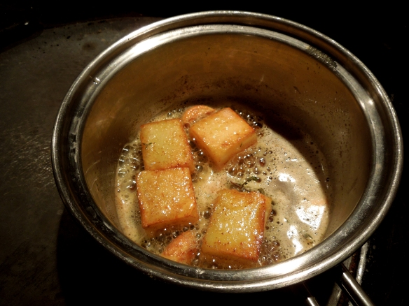 Image of fondant potatoes cooking