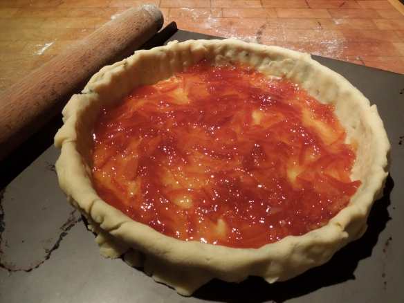 Image of tart base spread with marmalade