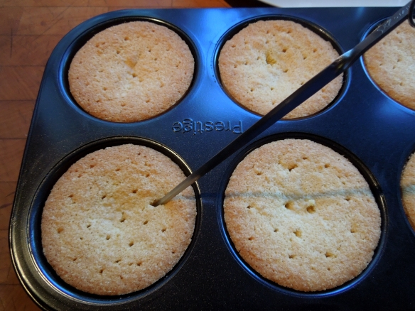 Image of holes being skewered in cakes