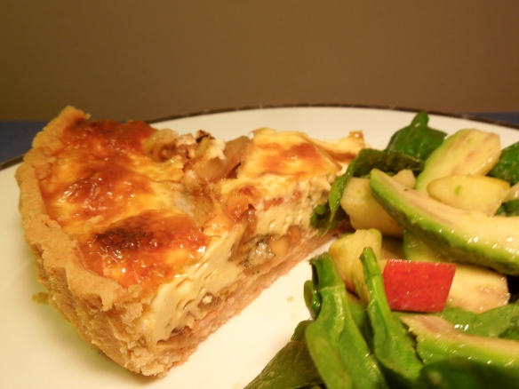 Image of slice of tart served with salad