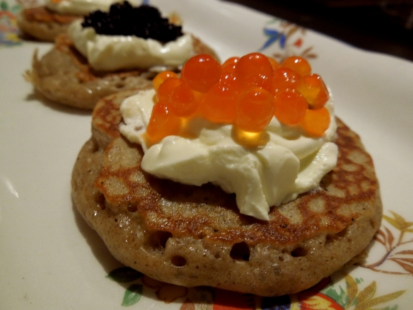 Image of blinis served with creme fraiche and caviar