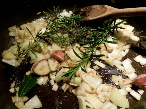 Image of vegetables and herbs frying