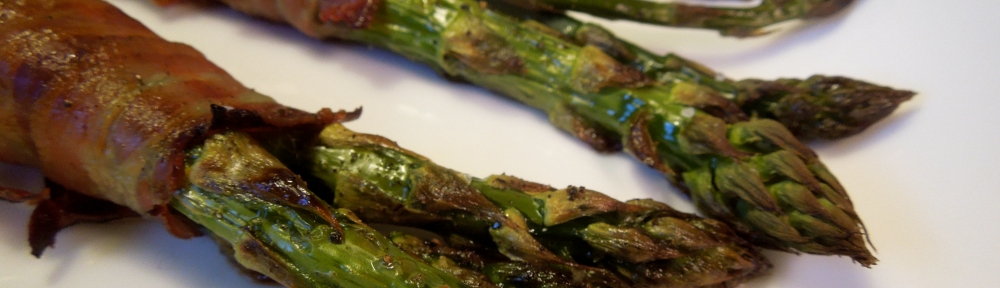 Image of pancetta-wrapped asparagus, served