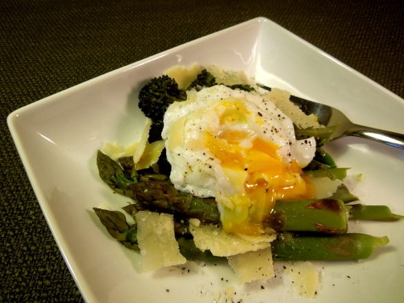 Image of asparagus and purple sprouting broccoli served with a paoched egg and parmesan shavings