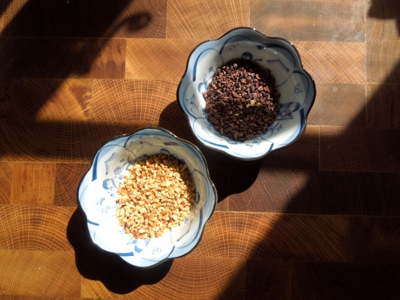 Image of chopped toasted hazelnuts and cocoa nibs