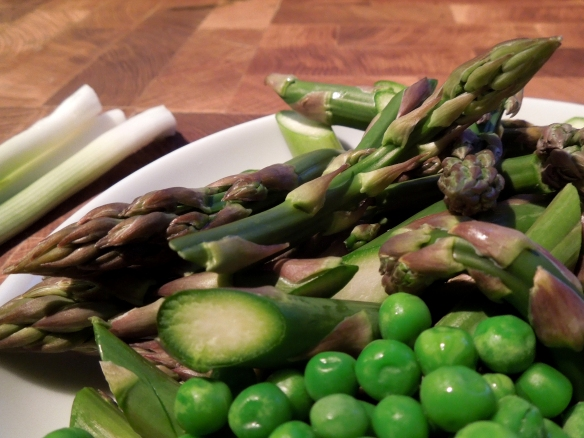 Image of raw asparagus, spring onions and peas