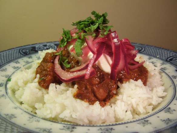 Image of chicken mole with cocoa nibs, served