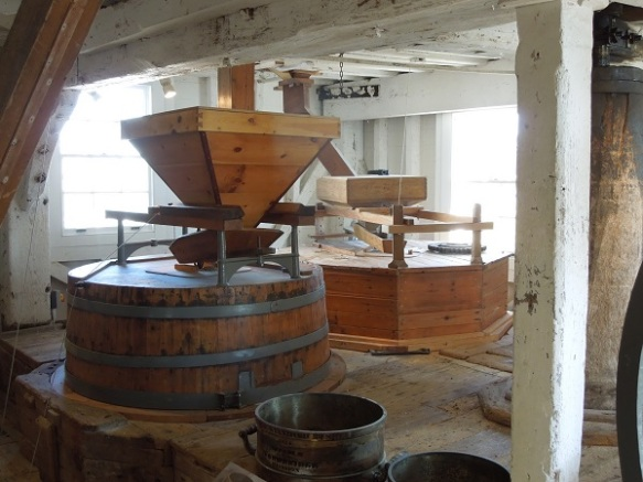 Image of grain hopper and milldstones at Woodbridge Tide Mill