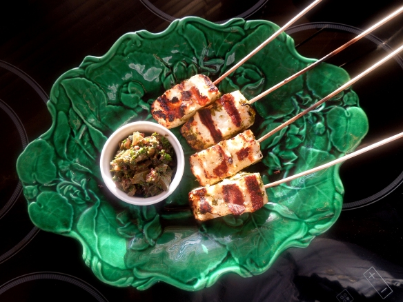 Image of halloimi lollipops with salsa verde