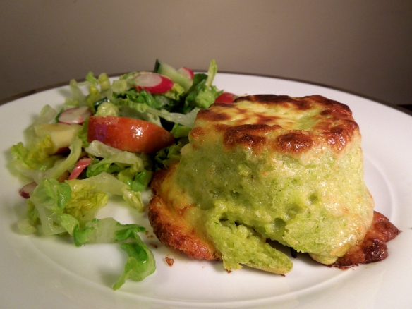 Image of twice-baked asparagus and goat's cheese souffle served with salad