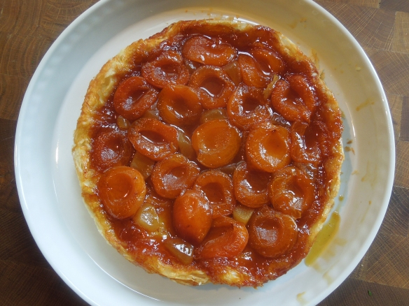Image of apricot and ginger tarte tatin inverted onto serving plate