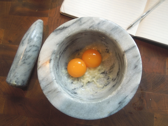 Image of egg yolks with garlic paste