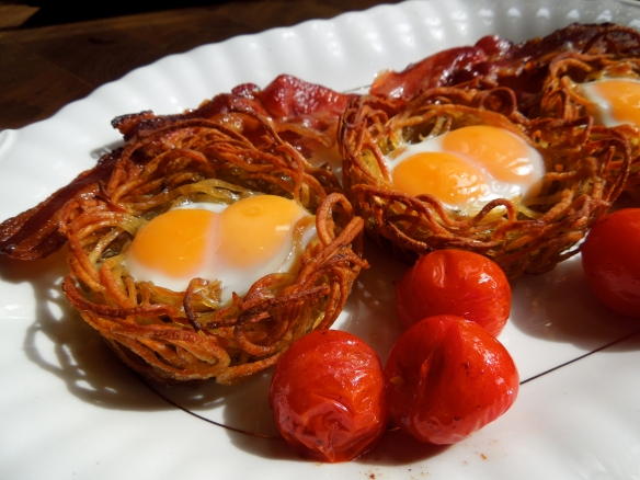 Image of eggs in potato nests, served
