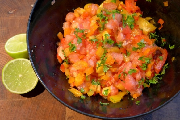 Image of tomato and pepper salsa with lime