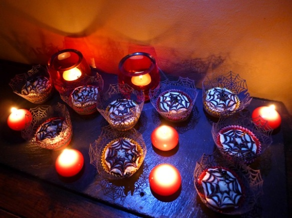 Image of cobweb cupcakes by candlelight