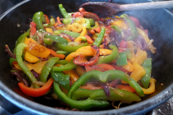 Image of peppers and onions cooking