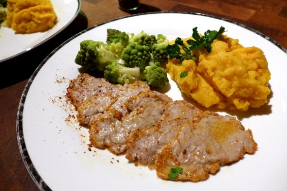 Image of pork fillet with citrus and pepper, served