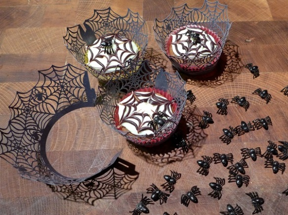 Image of cobweb cupcakes with cobweb wrapper and spiders