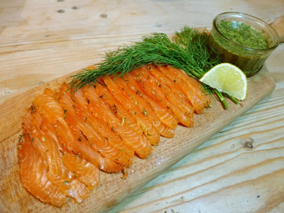 Image of gravadlax sliced on a board