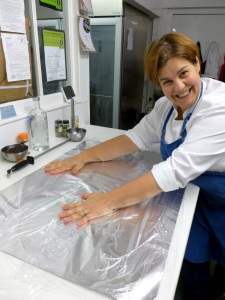 Image of Jackie laying out the wrapping for the salmon