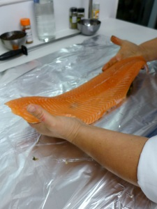 Image of salmon being laid on cure