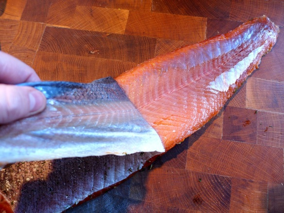 Image of cured salmon being skinned