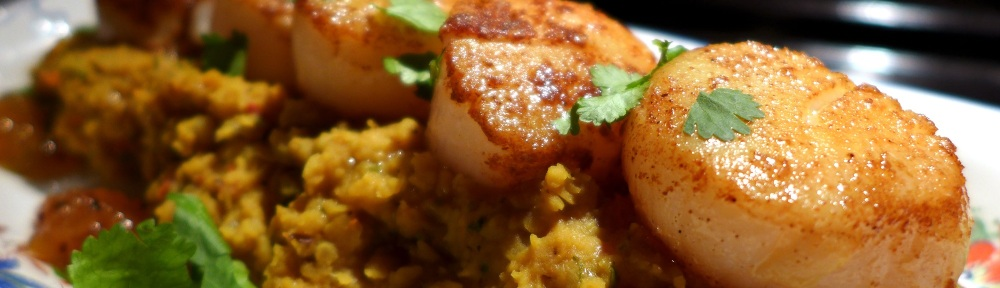 Image of spiced scallops with dhal, served