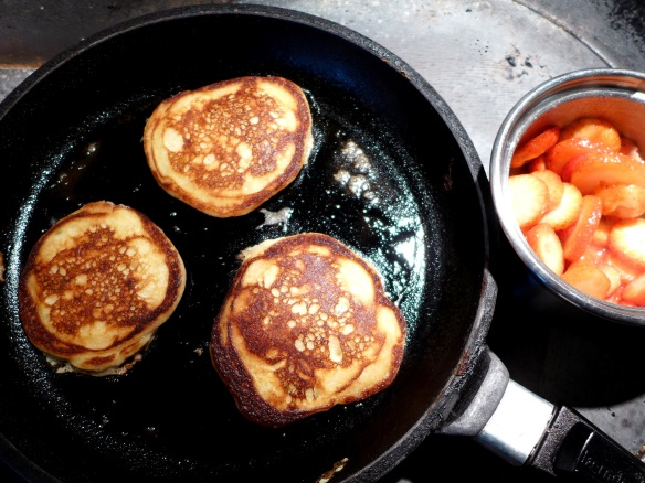 Image of pancakes and strawberries on stove