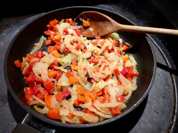 Image of onions and peppers in pan