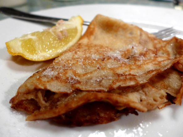 Image of classic pancake with sugar and lemon