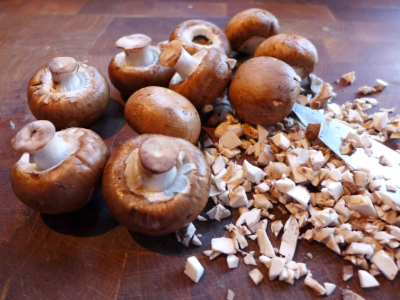 Image of fresh mushrooms being chopped