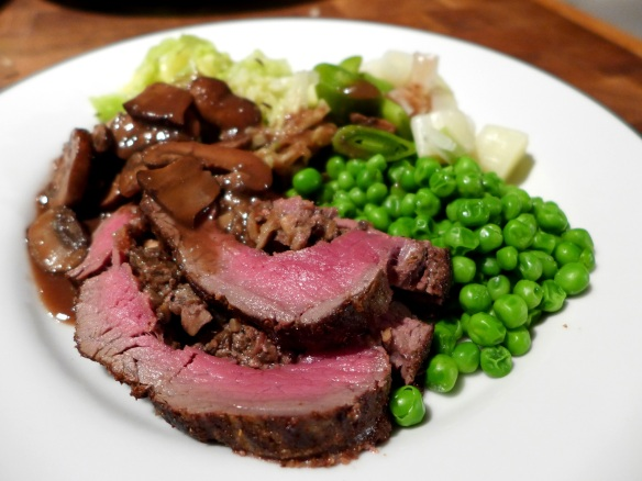 Image of beef, served with mushroom sauce and veg