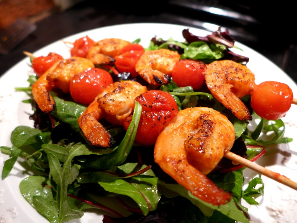 Image of piri piri prawn skewers, served