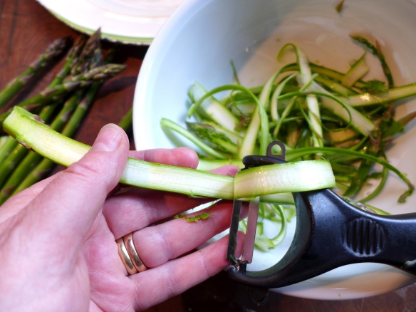 Image of asparagus sahved with a vegetable peeler