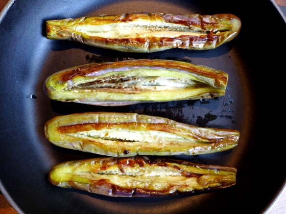 Image of aubergines slit open