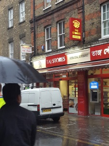 Image of Taj Stores exterior in the rain