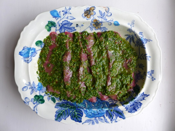 Image of steaks marinating in chimichurri