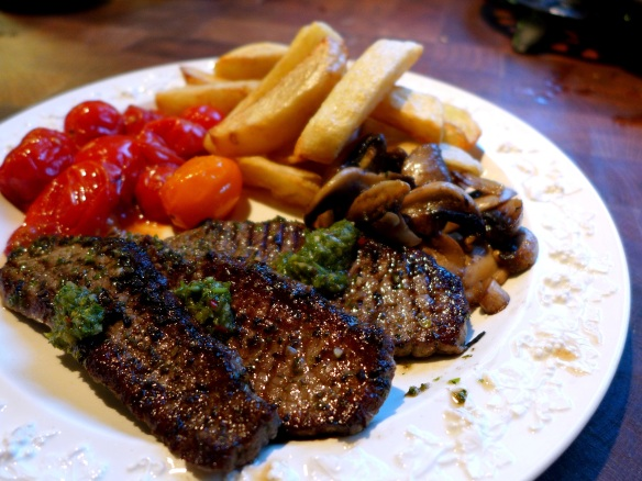 Image of minute steaks with chimichurri, served