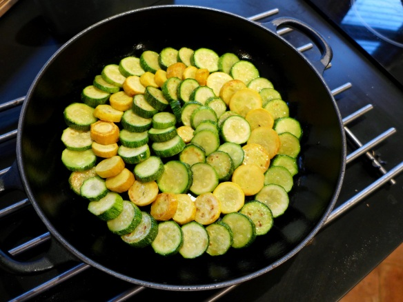 Image of courgettes arranged in pan